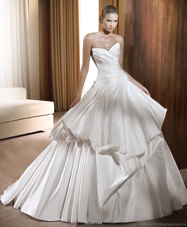 Wedding dress will ballgown silhoutte and puffy pickup detail on skirt